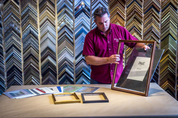 rob owner displaying frames