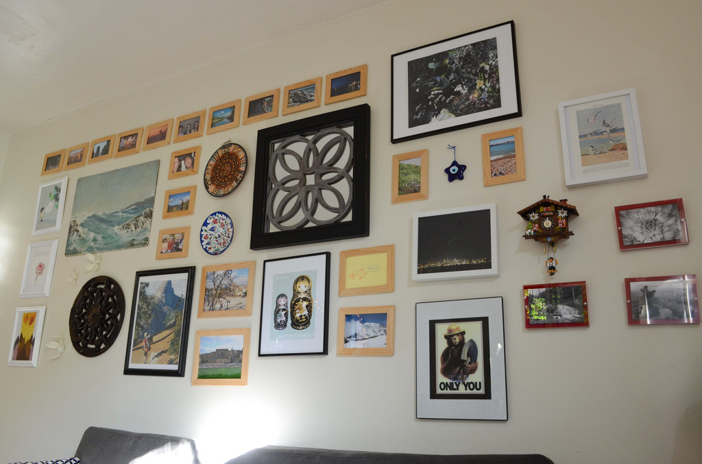 The Best Way To Hang Grouped Photo Frames